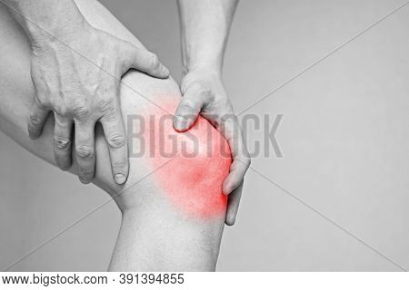 Man Having Knee Pain. Health Care Concept. Man Suffering From Pain In Knee. Black And White Photo Wi