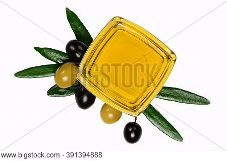 Olive Oil. Greek Olive Oil In Square Glass Transparent Bowl With Leaves And Marinated Olives. Close-