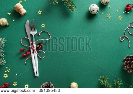 Christmas Table Setting With Fir Branch And Ornaments On Green, Flat Lay, Copy Space. Christmas Dinn