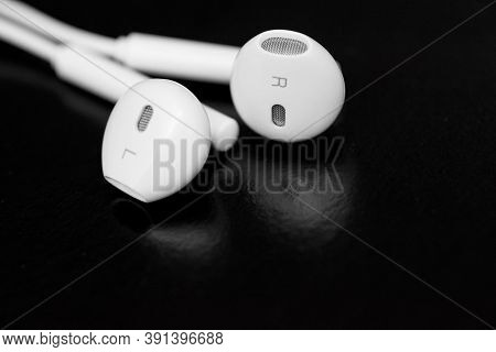 White Earphones On Black Background. Copy Space. Music Is My Life Concept. Earbuds Or Earphones On B
