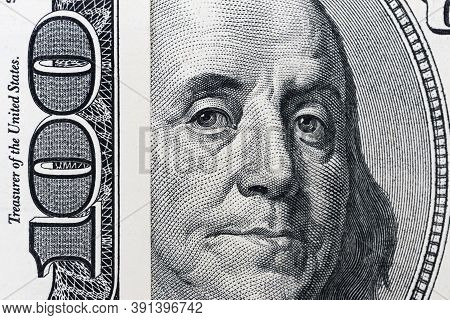 Benjamin Franklin's Eyes From A Hundred-dollar Bill. The Eyes Of Benjamin Franklin On The Hundred Do