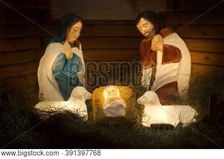 Nativity Scene Of Christ With Colored Figures. Christmas Nativity Scene