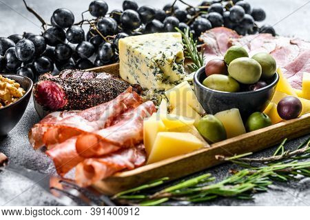 Antipasto Various Appetizer, Cutting Board With Prosciutto, Salami, Coppa, Cheese And Olives. Gray B