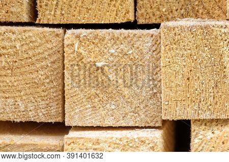 Lumber Close-up In Sawmill, Ends Of Timber Blocks For Texture Background. New Sawed Wood In Storage,