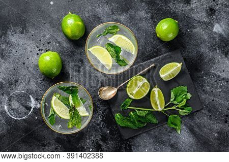 Mojito Cocktail, Refreshing Mint With Rum And Lime, Cold Drink Or Beverage. Black Background. Top Vi