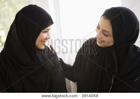 Middle Eastern Mother And Daughter Chatting At Home