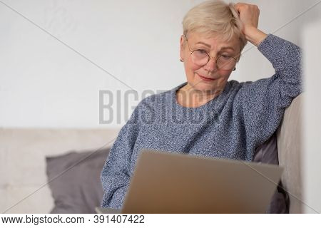 Mature Woman Working With Laptop At Home