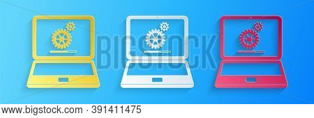 Paper Cut Laptop And Gears Icon Isolated On Blue Background. Adjusting App, Service, Setting Options