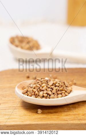 Buckwheat Grain Dry Buckwheat. Close-up Of Brown Buckwheat Groats. Healthy Food.