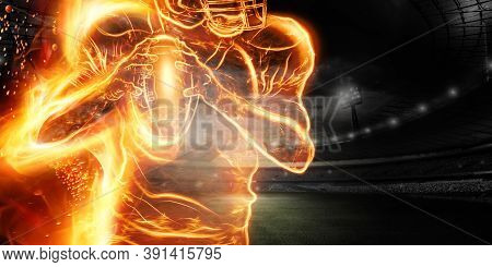 Silhouette Of An American Football Player On Fire On The Background Of The Stadium. Concept For Spor