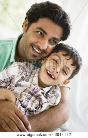 Middle Eastern Father With Child At Home