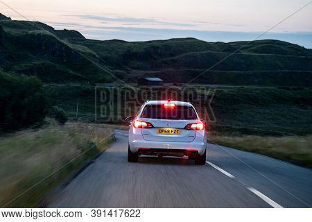 Scotland - August 5, 2019: White Opel Vauxhall Astra Combi Ecotec Car On A British Roads During The