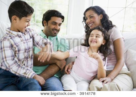 Family in living room play fighting and smiling (high key/selective focus) poster