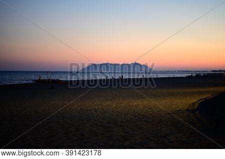 View On Sandy Beach In Small Touristic Coastal Town Terracina And Sea Shore, Latina, Italy On Dusk I