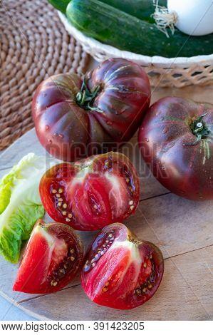 Making Green Salad With Big Ripe Raddish-purple Heirloom Tomatoes Black Crimea