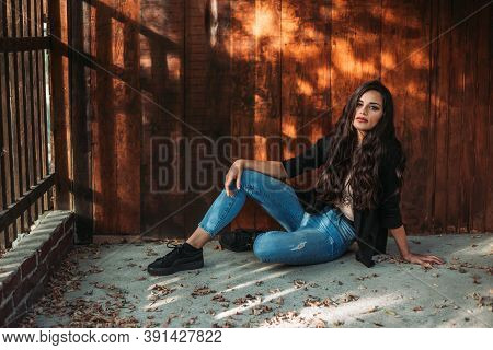 Portrait Of A Young Brunette Girl. Wooden Background, Fall Vibes