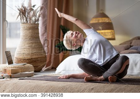 Mature Woman Doing Stretching Yoga Side Bend