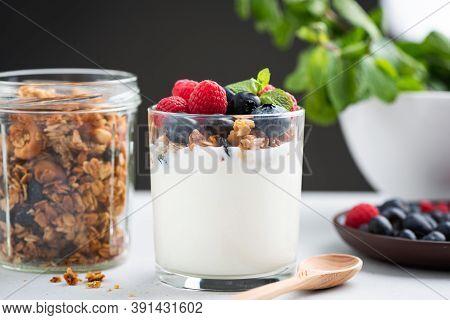 Yogurt Granola Parfait With Berries. Greek Yogurt With Oat Honey Granola, Raspberries And Blueberrie