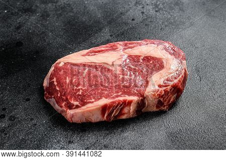 Raw Steak Ribeye. Black Angus Rib Eye. Black Background. Top View
