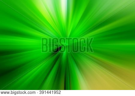 Abstract Green Zoom Effect Background. Digitally Generated Image. Rays Of Green Light. Colorful Radi