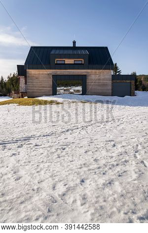 Wooden House With Large Reflective Mirror Window, Design Wall, Modern Architecture, Sunny Winter Day