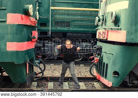 A Man Between Two Trains. Resistance To Mechanical Engineering. Human Versus Machines. Struggle With