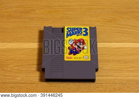 Super Mario Bros. 3 For The Nintendo Entertainment System. A Popular Retro Title, On A Wood Floor.