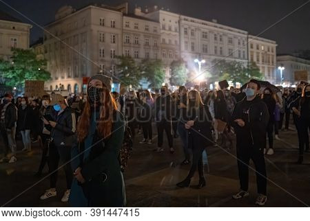 Krakow, Poland - October 24, 2020: People In Masks During Corona Virus Pandemic Have Nationwide Stri