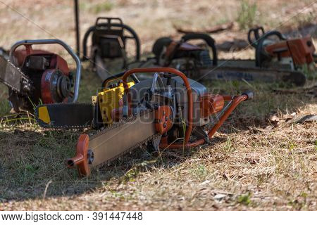 Prospect, Oregon / Usa - August 16, 2014:  An Antique Chainsaw Sits In The Shade With Other Power Sa