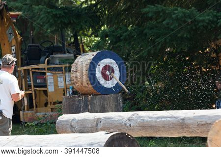 Prospect, Oregon / Usa - August 16, 2014: A Judge Watches An Axe Hit Its Target During A Skill Compe