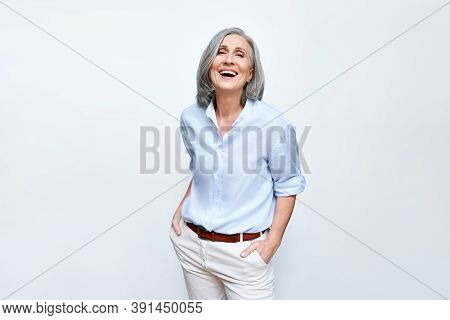 Happy Elegant Mature Senior Business Woman Laughing Standing Isolated On Grey Background. Smiling Co