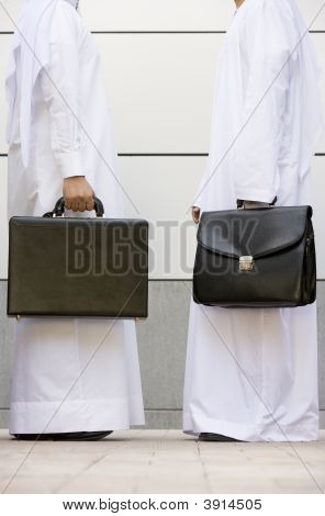 Middle Eastern Business Men Facing One Another
