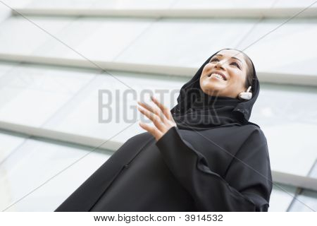 Middle Eastern Business Woman Stood Outside Offices With Set