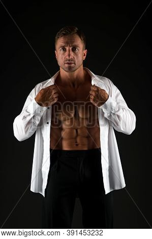 Building Strong Business. Athletic Man In Formal Style Black Background. Sexy Bachelor With Six Pack
