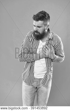 Oh My Heart. Bearded Man Suffer From Heart Pain. Hipster Hold Hand On Heart. Cardiovascular Health.