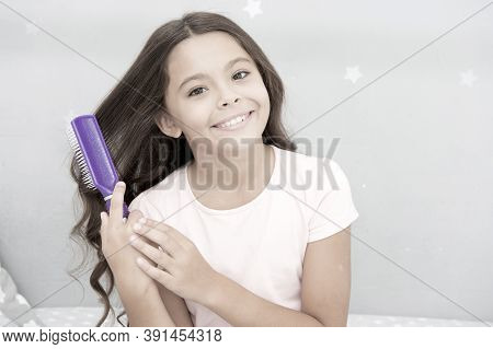 Conditioner Or Mask Organic Oil Comb Hair. Beauty Salon Tips. Girl Long Curly Hair Grey Interior Bac