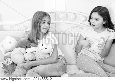 Kids Play Toys In Bed. Little Girls Spend Time Together. Teach Sister Sharing Toys. Greedy Sisters.