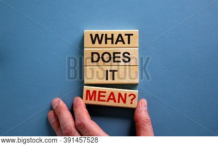 Male Hand Placing A Block With Word 'mean' On A Blocks Tower With Words 'what Does It Mean'. Beautif