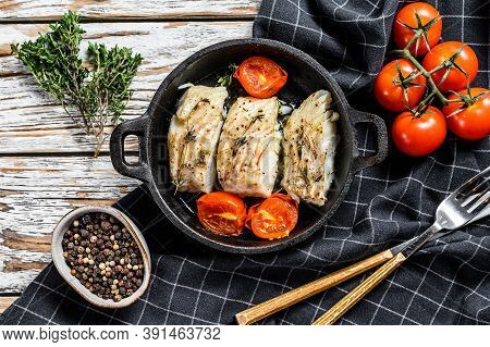 Grilled Pollock Or Coalfish Fillets In A Pan. White Background. Top View