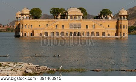 Afternoon View Of Jal Mahal Palace With An Egret On The Shore At Jaipur