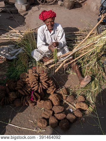 Jaipur, India - March 20, 2019: An Indian Man Sells Dung Fuel In Jaipur