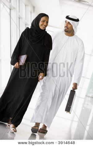 Middle Eastern Business Man / Woman Walking Down Corridor