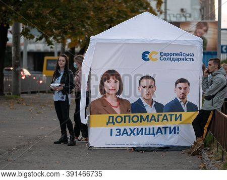 Dnipro, Ukraine - October 23, 2020: Agitators Hand Out Leaflets At Campaign Cubes Ahead Of Parliamen