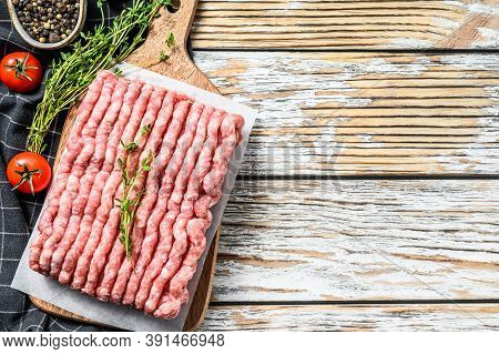 Raw Minced Pork On A Chopping Board. Organic Ground Meat, Forcemeat. White Background. Top View. Cop
