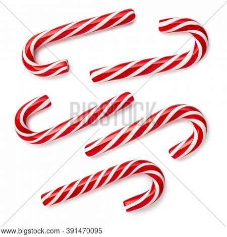 Candy Cane - classic Christmas treat. Set of festive sweets on white background. Flat lay, top view