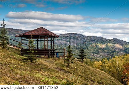 Wooden Alcove In The Mountains On An Autumn Day