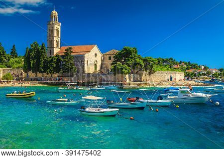 Wonderful Bay With Beach And Boats. Spectacular Walkway And Stone Church With Tower On The Waterfron