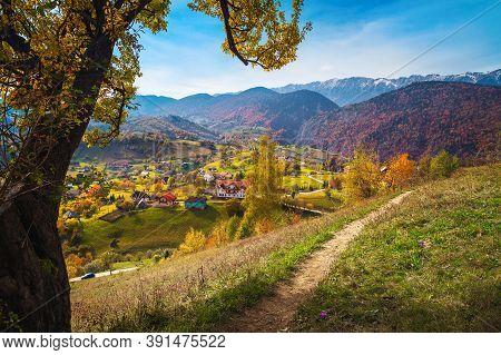 Stunning Autumn Landscape With Mountain Village And Zarnesti Gorge In Background, Magura, Transylvan