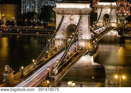 Chain bridge on Danube river in Budapest at night, Hungary. Long exposure shot. Famous Szechenyi Chain Bridge illuminated at night