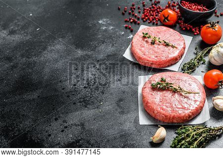 Raw Mince Meat Cutlet, Ground Beef And Pork. Burger Patties. Black Background. Top View. Copy Space